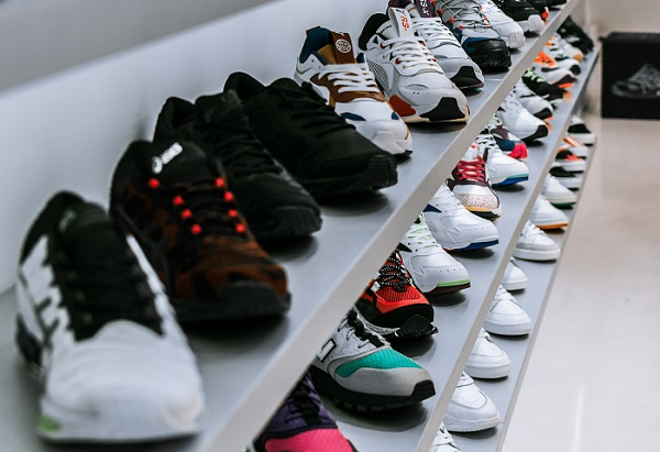 sneakers on the three tier shelves