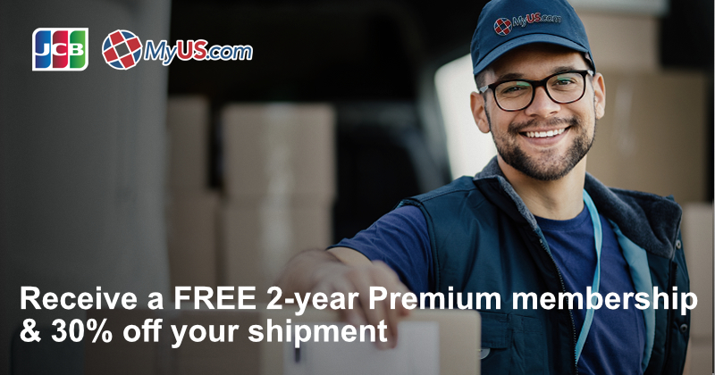 warehouse worker in a baseball cap smiling